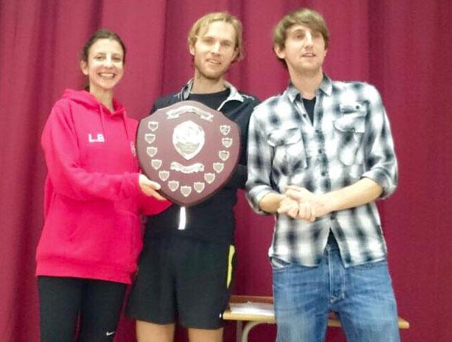 Representatives from Lewes AC accepting the shield for winning team (L to R: Lara Barrazuol, David Bradford and Matt Bradford from Harvey Curtis)