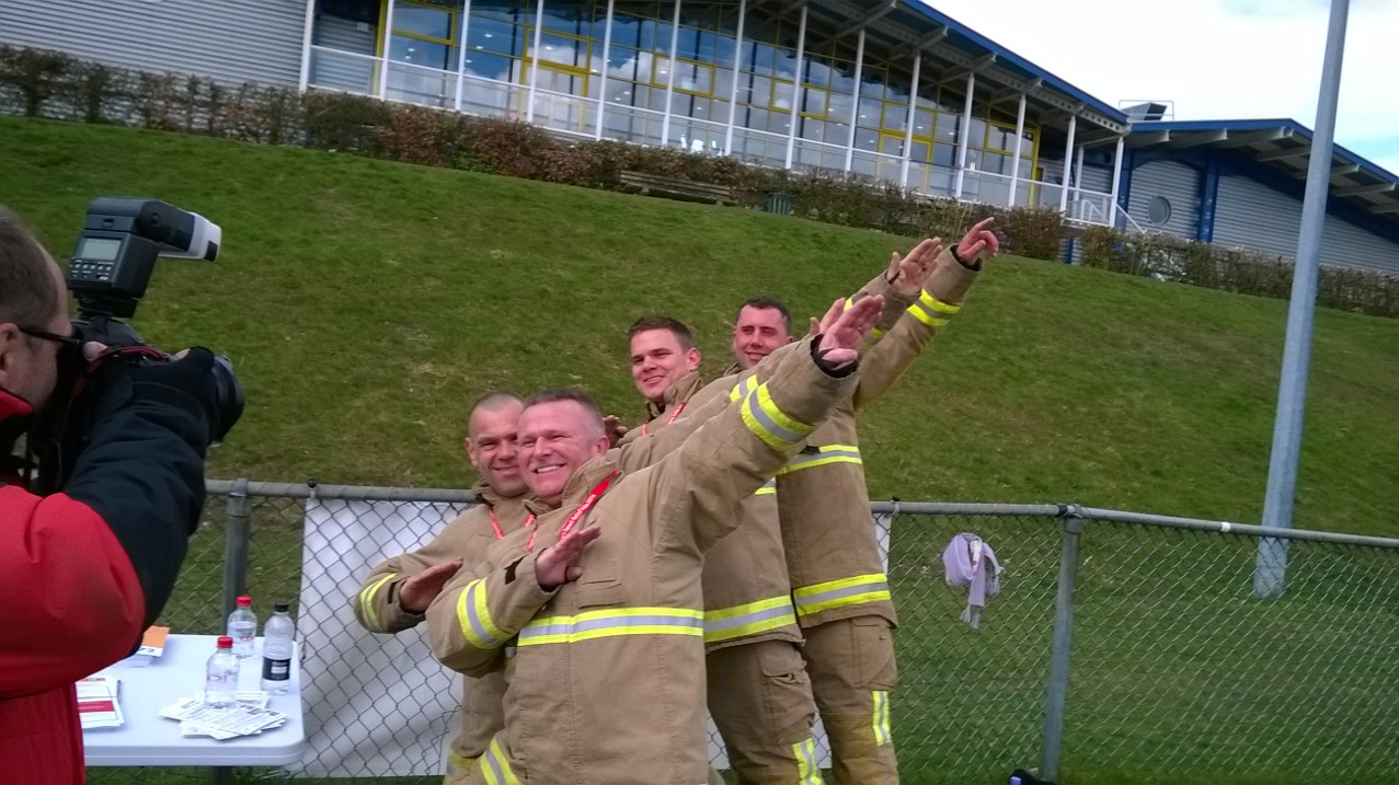 Firefights posing for photographs.
