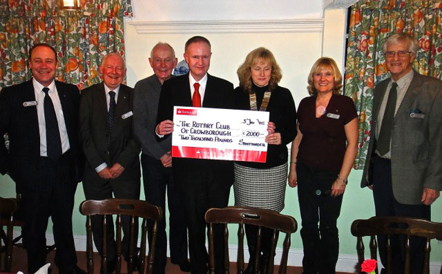 Ian Appleyard Manager of Santander Crowborough presents President Helen Marshall with a cheque for £2,000