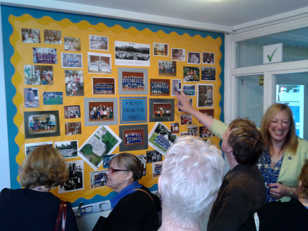 A Blast from the Past, Headteacher Mrs Maria Cowler looking at the old photos