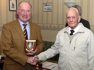 Club Captain Roger Benison on left and Neville Stone BEM of the Royal British Legion on right making the presentation.
