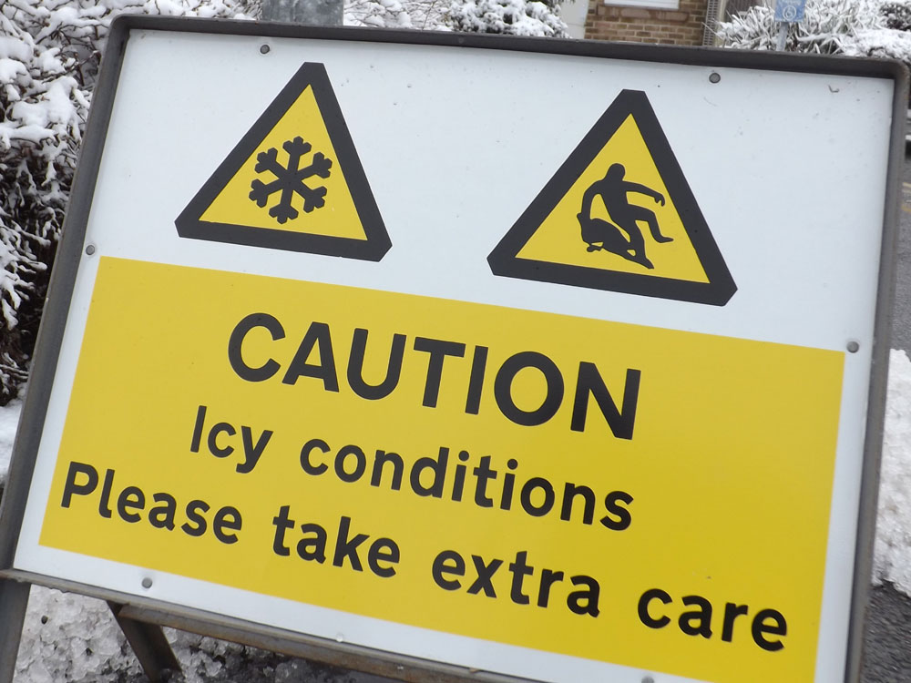 "Caution Icy Conditions ""Please take extra care"" sign"