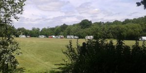 A group of travellers have set-up camp on playing fields belonging to Beacon Academy adjacent to Poundfield Path.