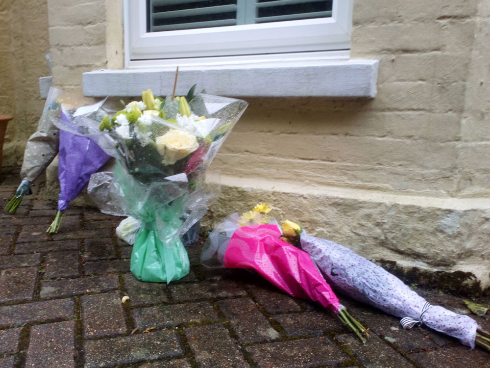 "Tributes to Fiona Fisher left outside her home ""Queensbury"" on Lordswell Lane in Crowborough"