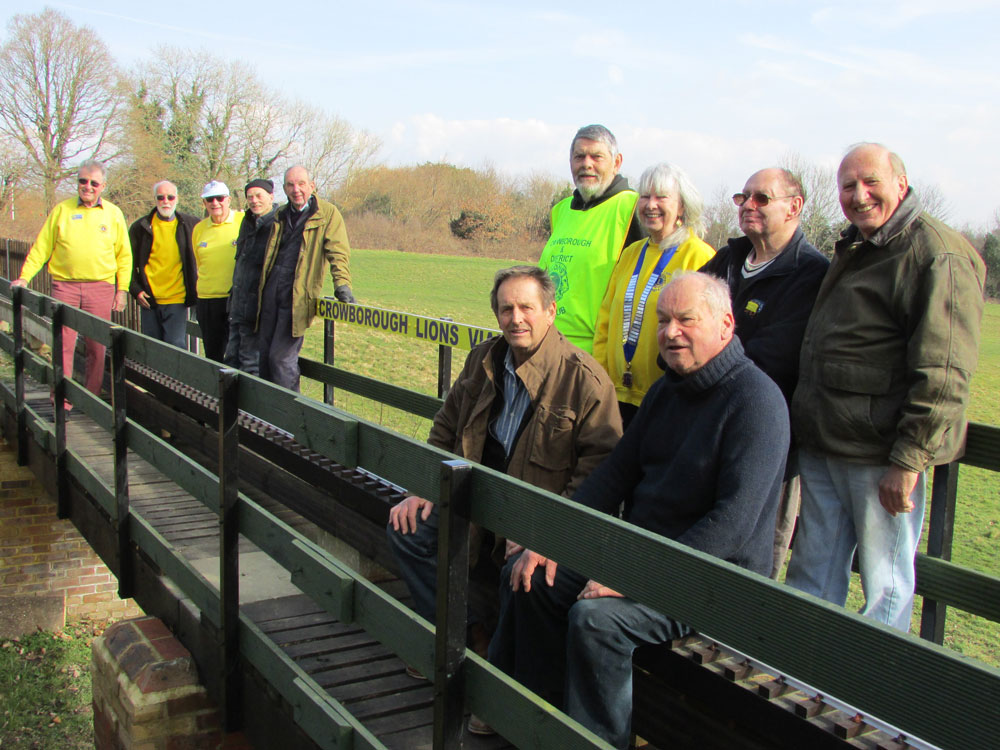 Pictured at the opening of the Crowborough Lions Viaduct from left to right are (in yellow tops) Lions Frank Lees, Alan Cridland, David Martin, Brian Meyers & President Hilary Lyon together with Locomotive Society members Deryck Munk, Graham Fry, Malcolm Barmby & Neville Watts (both seated), Peter Cavill and Malcolm Plaice.