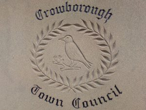 Crowborough Town Council logo part of the stonework of the Whitehill Centre on Whitehill Road