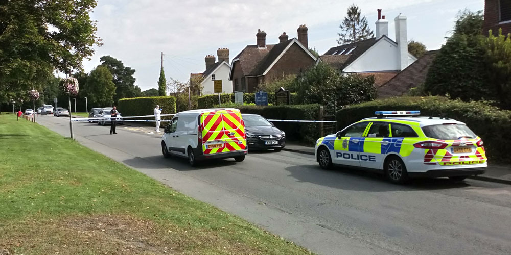 Police cordon at Chapel Green in Crowborough - police and scenes of crime officer on site.
