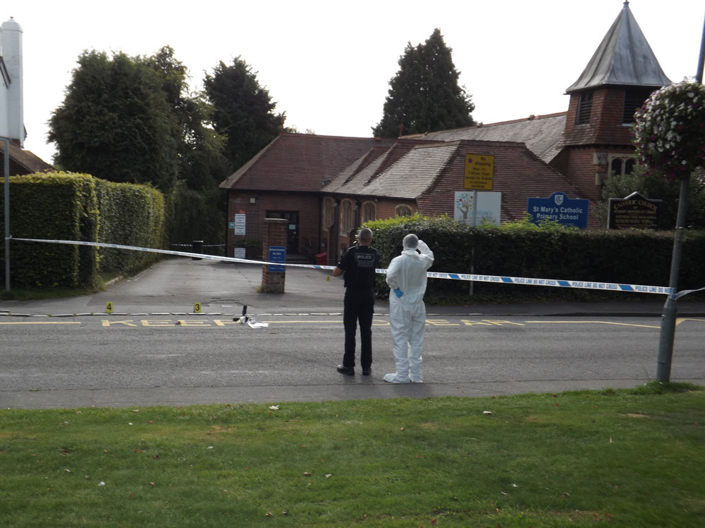 Evidence markers outside St Mary's Catholic Church at Chapel Green in Crowborough.