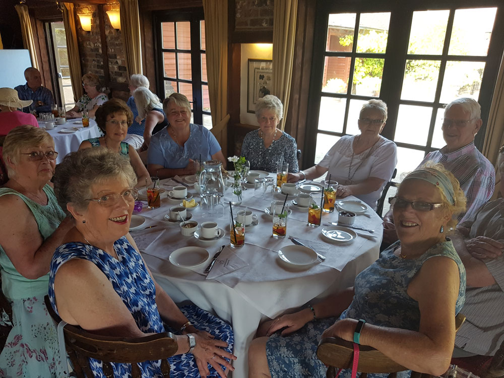 Members of the Bereavement Group enjoying afternoon tea at Barnsgate Manor (including Brenda Smart, front right)