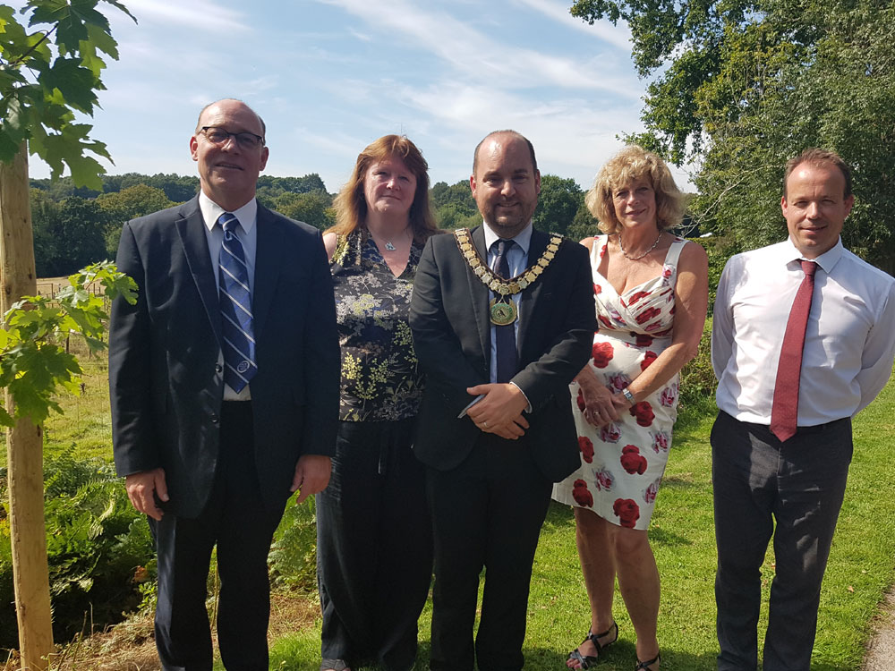 Photo of the following four people stood by the red maple tree: Stephen Tester, co-founder of Tester & Jones; Sue Carswell, Tester & Jones Bereavement Group; Councillor Greg Rose, Mayor of Crowborough; Glenys Jones, co-founder of Tester & Jones; and Gary Mitchell, Operations Manager, Barnsgate Manor.