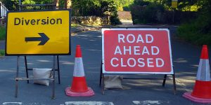Diversion and Road Ahead Closed signs