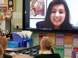Nus Ghani MP on projector screen via WhatsApp