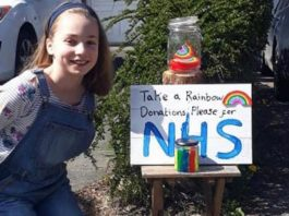 Olivia Anker and the share containing her rainbows to raise money for the NHS