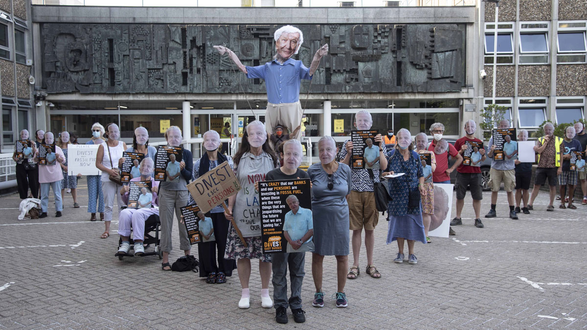 Supporters of Divest East Sussex holding an 'Attenborough-in' outside County Hall in Lewes to protest the Council's ongoing investment in fossil fuel companies.
